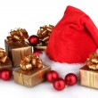 Stock Photo: Beautiful Christmas hat, gifts and Christmas balls isolated on white