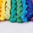 Sewing threads for embroidery on white cotton — Stock Photo