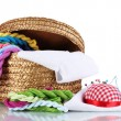 Royalty-Free Stock Photo: Bright threads for needlework and fabric in a wicker basket