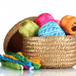 Stock Photo: Bright threads for needlework and fabric in wicker basket