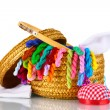 Bright threads for needlework and fabric in a wicker basket — Stock Photo #8114266