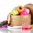 Bright threads for needlework and fabric in a wicker basket — Stock Photo #8114277