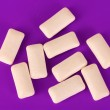 Stock Photo: Chewing gums on purple background