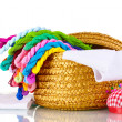 Bright threads for needlework and fabric in a wicker basket — Stock Photo #8114292