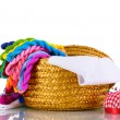 Bright threads for needlework and fabric in a wicker basket — Stock Photo #8114299