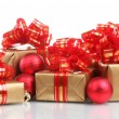Beautiful golden gifts with red ribbon and Christmas balls isolated on whit — Stock Photo