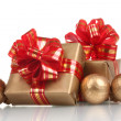 Beautiful golden gifts with red ribbon and Christmas balls isolated on whit — Foto de Stock