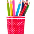 Red glass with colorful pencils isolated on white — Stock Photo #8114628