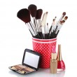 Red glass with brushes and cosmetics isolated on white — Stock Photo #8114938
