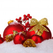 Beautiful red Christmas balls and cones on snow isolated on white — Stock Photo #8115433