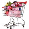 Beautiful bright Christmas balls and gifts in the cart isolated on white — Stock Photo