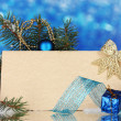 Blank postcard, Christmas balls and fir-tree on blue background — Stock Photo #8115880