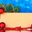 Blank postcard, Christmas balls and fir-tree on blue background — Foto Stock