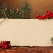 Blank postcard, Christmas balls and fir-tree on wooden table on brown backg — Stock fotografie