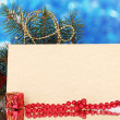Blank postcard, gifts and fir-tree on blue background - Foto Stock