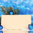 Blank postcard, Christmas balls and fir-tree on blue background -  