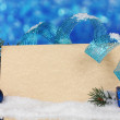 Blank postcard, Christmas balls and fir-tree on blue background - Foto Stock