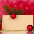 Blank postcard, Christmas balls and fir-tree on red background - Stockfoto