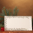 Blank postcard, Christmas balls and fir-tree on wooden table on brown backg - Stockfoto