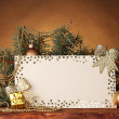 Blank postcard, Christmas balls and fir-tree on wooden table on brown backg -  