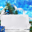 Blank postcard, Christmas balls and fir-tree on blue background — Stock Photo #8116033