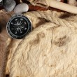 Old paper, compass and rope on a wooden table - Stockfoto