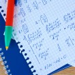 Math on copybook page closeup — Stock Photo #8116182