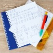 Math on copybook page on wooden table — Stock Photo #8116184