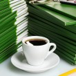 Many green folder with cup of coffee closeup — Foto Stock