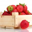 Strawberries in wooden box isolated on white - Stock Photo