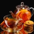Glass teapot and cup with black fruit tea and cookies isolated on white — Stock Photo #8119156
