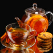 Glass teapot and cup with black fruit teand cookies isolated on white — Stock Photo #8119156