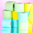 Bright rolls of toilet paper on pink background — Stock Photo #8119506