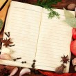 Notebook for recipes and spices on wooden table — Stock Photo #8119912