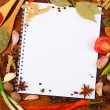 Notebook for recipes and spices on wooden table — Foto de Stock