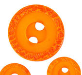 Bright orange sewing buttons isolated on white — Stock Photo
