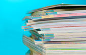 Stack of magazines on blue background — Stock Photo