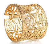 Beautiful gold bracelet isolated on white — Stock Photo