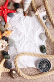 Blank paper on sand beach with seashells and starfishes — Stock Photo