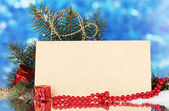 Blank postcard, gifts and fir-tree on blue background — Стоковое фото