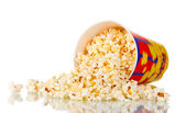 Full bucket of popcorn dropped isolated on white — Stock Photo