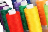 Many-coloured bobbins of thread closeup — Stock Photo