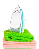 Two towels and iron isolated on white — Stock Photo