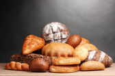 Delicious bread on wooden table on gray background — Stock Photo