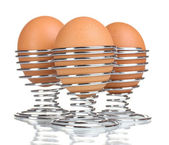 Boiled eggs in metal stands isolated on white — Stock Photo