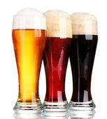 Three glasses with different beers isolated on white — Stok fotoğraf