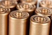 Golden batteries closeup — Stock Photo