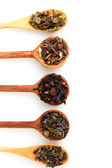 Different kinds of green and black dry tea in woooden spoon isolated on whi — Stock Photo