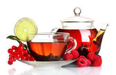 Black fruit tea in glass teapot and cup isolated on white — Stock Photo
