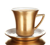 Golden cup of coffee isolated on white — Стоковое фото